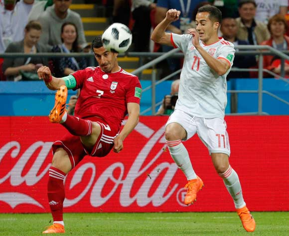 epa06825470 Ehsan Haji Safi (L) of Iran and Lucas Vazquez of Spain in action during the FIFA World Cup 2018 group B preliminary round soccer match between Iran and Spain in Kazan, Russia, 20 June 2018.