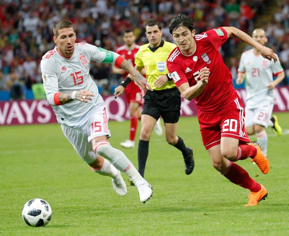 epa06825581 Sergio Ramos (L) of Spain and Sardar Azmoun of Iran in action during the FIFA World Cup 2018 group B preliminary round soccer match between Iran and Spain in Kazan, Russia, 20 June 2018.