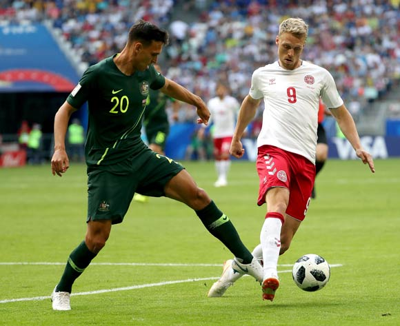 epa06827131 Nicolai Jorgensen of Denmark (R) and Trent Sainsbury of Australia in action  during the FIFA World Cup 2018 group C preliminary round soccer match between Denmark and Australia in Samara, Russia, 21 June 2018.