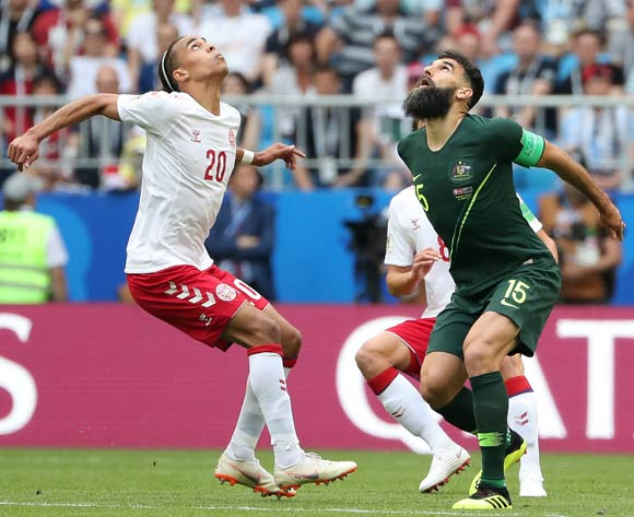 epa06827161 Yussuf Poulsen of Denmark (L) and Mile Jedinak of Australia in action during the FIFA World Cup 2018 group C preliminary round soccer match between Denmark and Australia in Samara, Russia, 21 June 2018.