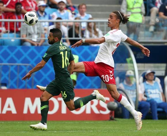 epa06827184 Yussuf Poulsen of Denmark (L) and Aziz Behich of Australia in action during the FIFA World Cup 2018 group C preliminary round soccer match between Denmark and Australia in Samara, Russia, 21 June 2018.