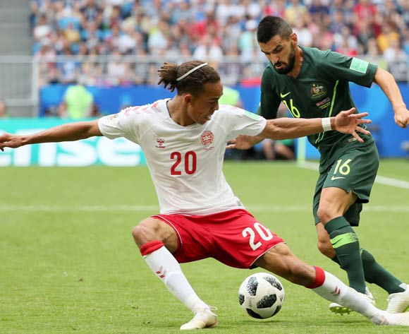 epa06827211 Yussuf Poulsen (L) of Denmark and Aziz Behich of Australia in action during the FIFA World Cup 2018 group C preliminary round soccer match between Denmark and Australia in Samara, Russia, 21 June 2018.