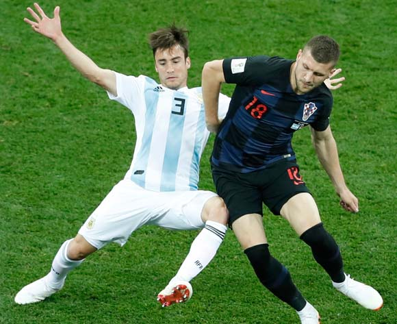 epa06828811 Ante Rebic (R) of Croatia and Nicolas Tagliafico of Argentina in action during the FIFA World Cup 2018 group D preliminary round soccer match between Argentina and Croatia in Nizhny Novgorod, Russia, 21 June 2018.