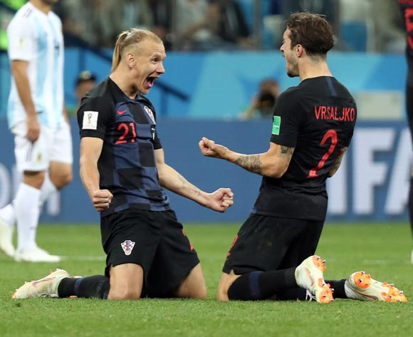 epa06829079 Domagoj Vida of Croatia (L) and Sime Vrsaljko of Croatia react after winning the FIFA World Cup 2018 group D preliminary round soccer match between Argentina and Croatia in Nizhny Novgorod, Russia, 21 June 2018.