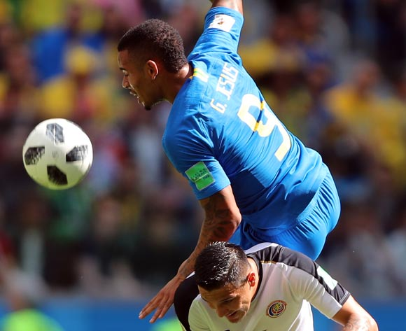 epa06830164 David Guzman of Costa Rica (down) and Gabriel Jesus of Brazil in action during the FIFA World Cup 2018 group E preliminary round soccer match between Brazil and Costa Rica in St.Petersburg, Russia, 22 June 2018.