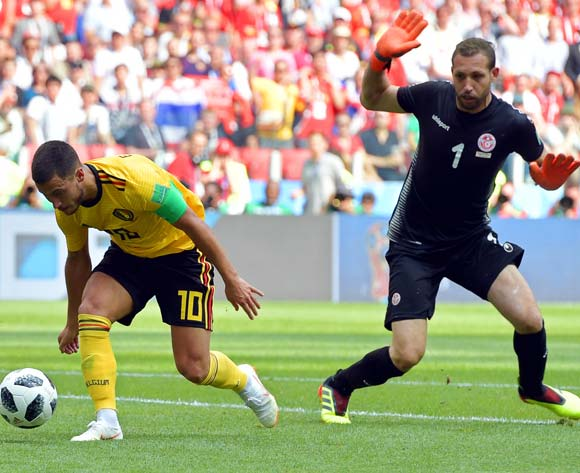 epa06833186 Eden Hazard (L) of Belgium scores the 4-1 lead against Tunisia's goalkeeper Farouk Ben Mustapha (R) during the FIFA World Cup 2018 group G preliminary round soccer match between Belgium and Tunisia in Moscow, Russia, 23 June 2018.