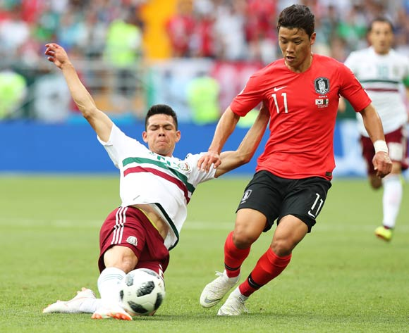 epa06833685 Hirving Lozano (L) of Mexico in action against Hwang Hee-chan (R) of South Korea during the FIFA World Cup 2018 group F preliminary round soccer match between South Korea and Mexico in Rostov-On-Don, Russia, 23 June 2018.