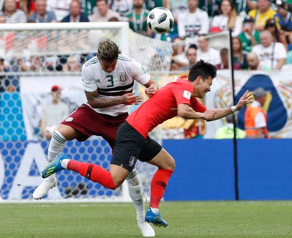 epa06833761 Carlos Salcedo (L) of Mexico and Son Heung-min of South Korea in action during the FIFA World Cup 2018 group F preliminary round soccer match between South Korea and Mexico in Rostov-On-Don, Russia, 23 June 2018.
