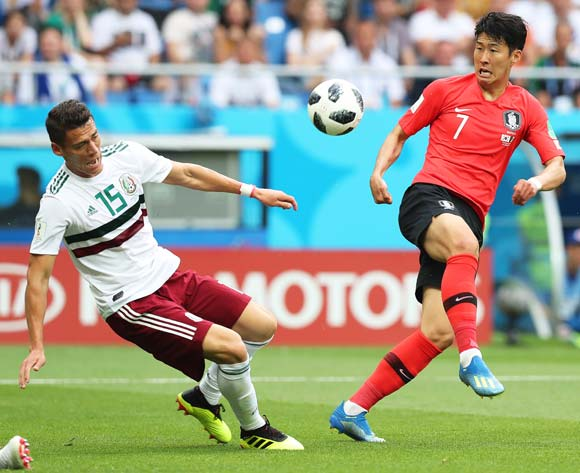 epa06833825 Hector Moreno (L) of Mexico in action against Son Heung-min (R) of South Korea during the FIFA World Cup 2018 group F preliminary round soccer match between South Korea and Mexico in Rostov-On-Don, Russia, 23 June 2018.
