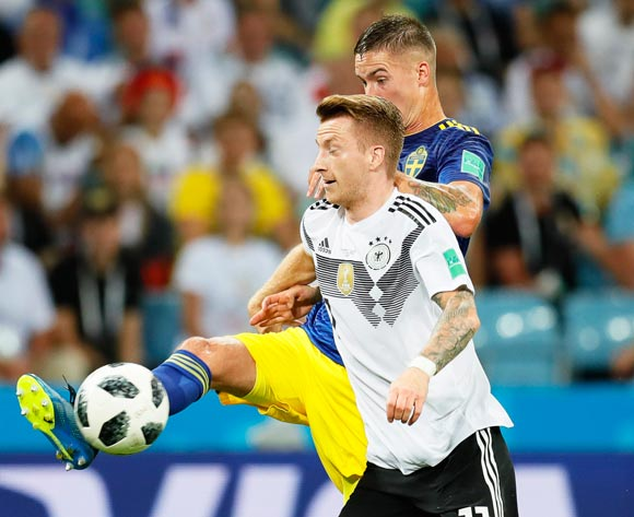 epa06834520 Mikael Lustig (back) of Sweden in action against Marco Reus (front) of Germany during the FIFA World Cup 2018 group F preliminary round soccer match between Germany and Sweden in Sochi, Russia, 23 June 2018.