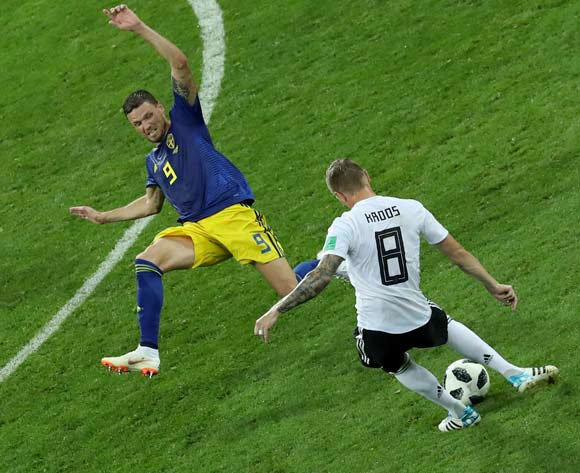 epa06834715 Toni Kroos  (R) of Germany takes a shot during the FIFA World Cup 2018 group F preliminary round soccer match between Germany and Sweden in Sochi, Russia, 23 June 2018.