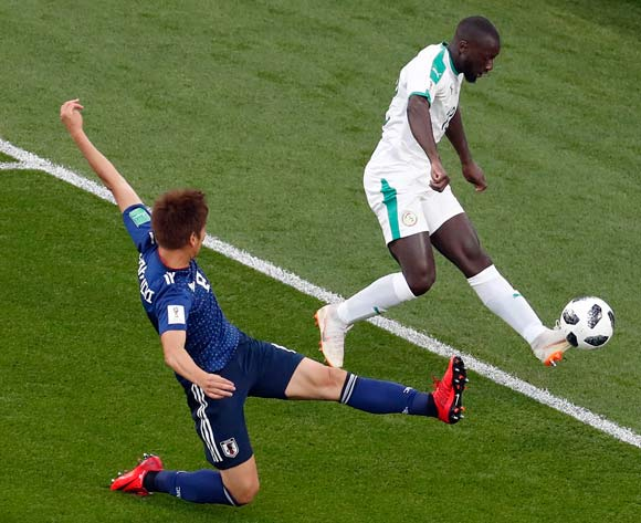 epa06836464 Genki Haraguchi of Japan (L) and Youssouf Sabaly of Senegal in action the FIFA World Cup 2018 group H preliminary round soccer match between Japan and Senegal in Ekaterinburg, Russia, 24 June 2018.