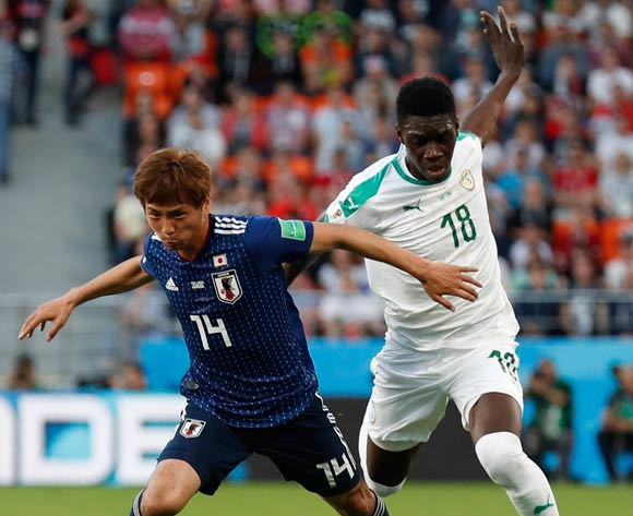 Takashi Inui (L) of Japan and Ismaila Sarr of Senegal in action during the FIFA World Cup 2018 group H preliminary round soccer match between Japan and Senegal in Ekaterinburg, Russia, 24 June 2018.