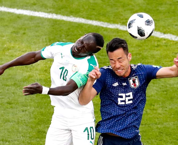 epa06836617 Maya Yoshida of Japan (R) and Sadio Mane of Senegal in action during the FIFA World Cup 2018 group H preliminary round soccer match between Japan and Senegal in Ekaterinburg, Russia, 24 June 2018.