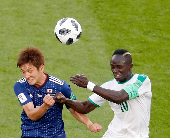 epa06836688 Sadio Mane of Senegal (R) and Genki Haraguchi of Japan in action during the FIFA World Cup 2018 group H preliminary round soccer match between Japan and Senegal in Ekaterinburg, Russia, 24 June 2018.