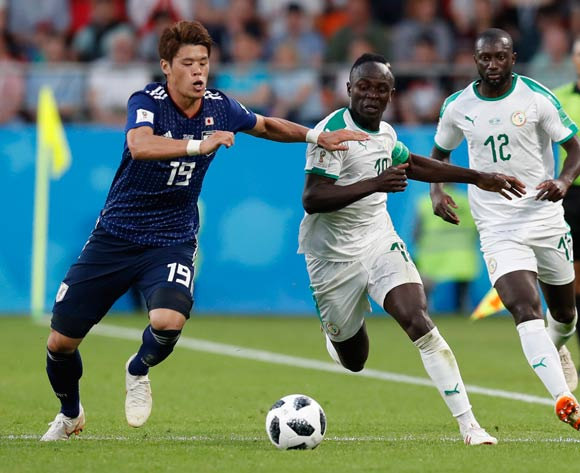 epa06836890 Hiroki Sakai (L) of Japan and Sadio Mane (2-L) of Senegal in action during the FIFA World Cup 2018 group H preliminary round soccer match between Japan and Senegal in Ekaterinburg, Russia, 24 June 2018.