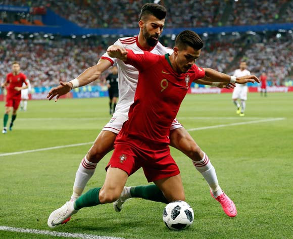 epa06839888 Andre Silva of Portugal (front) and Ramin Rezaeian of Iran in action during the FIFA World Cup 2018 group B preliminary round soccer match between Iran and Portugal in Saransk, Russia, 25 June 2018.