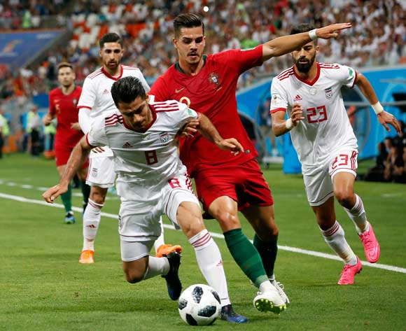 epa06839948 Andre Silva of Portugal (2R) and Morteza Pouraliganji of Iran during the FIFA World Cup 2018 group B preliminary round soccer match between Iran and Portugal in Saransk, Russia, 25 June 2018.