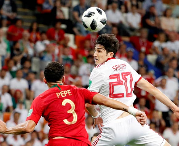 epa06839990 Pepe (L) of Portugal and Sardar Azmoun of Iran go for a header during the FIFA World Cup 2018 group B preliminary round soccer match between Iran and Portugal in Saransk, Russia, 25 June 2018.