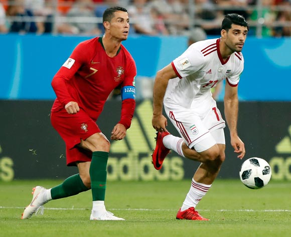 epa06840039 Cristiano Ronaldo of Portugal (L) and Mehdi Taremi of Iran in action during the FIFA World Cup 2018 group B preliminary round soccer match between Iran and Portugal in Saransk, Russia, 25 June 2018.