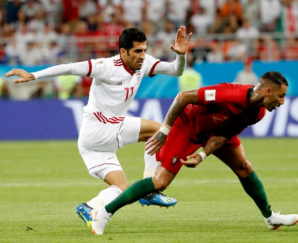 epa06840054 Vahid Amiri (L) of Iran and Ricardo Quaresma of Portugal in action during the FIFA World Cup 2018 group B preliminary round soccer match between Iran and Portugal in Saransk, Russia, 25 June 2018.
