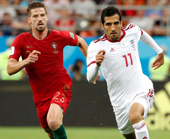 epa06840066 Vahid Amiri (R) of Iran and Adrien Silva of Portugal in action during the FIFA World Cup 2018 group B preliminary round soccer match between Iran and Portugal in Saransk, Russia, 25 June 2018.