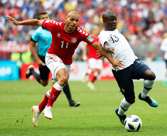 epa06841574 Martin Braithwaite (L) of Denmark in action against France's Ngolo Kante (R) during the FIFA World Cup 2018 group C preliminary round soccer match between Denmark and France in Moscow, Russia, 26 June 2018.