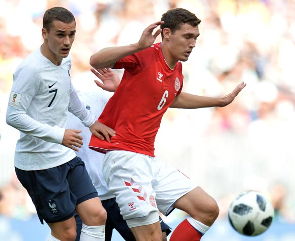 epa06841586 Antoine Griezmann (L) of France and Andreas Christensen of Denmark in action during the FIFA World Cup 2018 group C preliminary round soccer match between Denmark and France in Moscow, Russia, 26 June 2018.