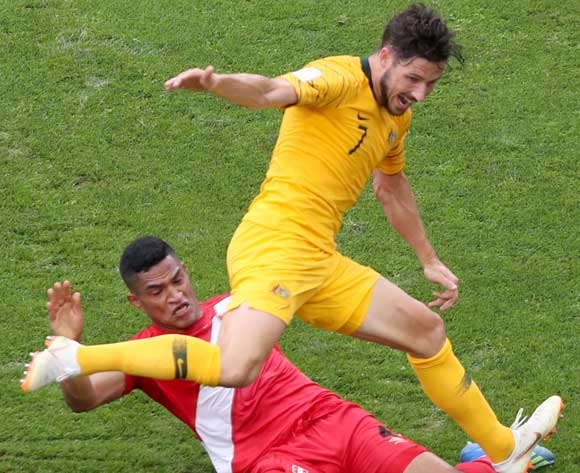 epa06841603 Anderson Santamaria (down) of Peru and Mathew Leckie of Australia in action during the FIFA World Cup 2018 group C preliminary round soccer match between Australia and Peru in Sochi, Russia, 26 June 2018.