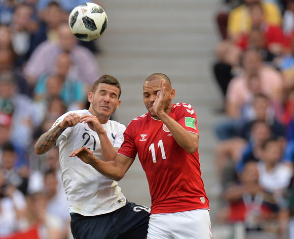 epa06841611 Martin Braithwaite (R) of Denmark and Lucas Hernandez of France in action during the FIFA World Cup 2018 group C preliminary round soccer match between Denmark and France in Moscow, Russia, 26 June 2018.