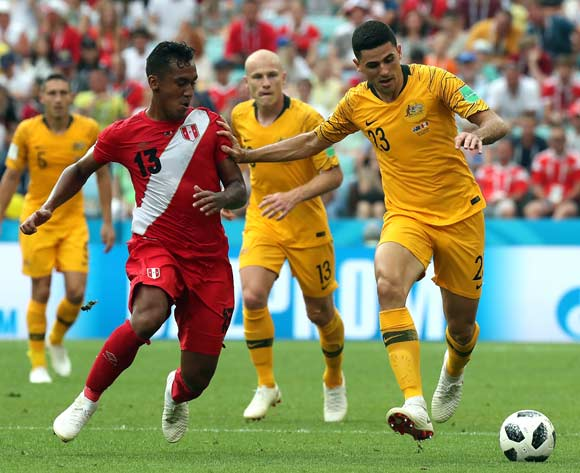 epa06841679 Renato Tapia of Peru (L) and Tom Rogic of Australia during the FIFA World Cup 2018 group C preliminary round soccer match between Australia and Peru in Sochi, Russia, 26 June 2018.