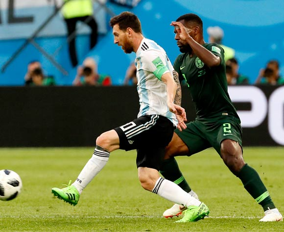 epa06842573 Lionel Messi of Argentina (L) and Bryan Idowu of Nigeria in action during the FIFA World Cup 2018 group D preliminary round soccer match between Nigeria and Argentina in St.Petersburg, Russia, 26 June 2018.