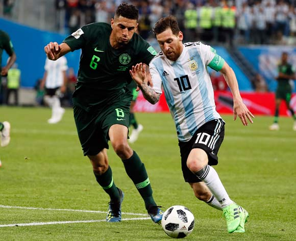 epa06842826 Lionel Messi of Argentina (R) and Leon Balogun of Nigeria in action during the FIFA World Cup 2018 group D preliminary round soccer match between Nigeria and Argentina in St.Petersburg, Russia, 26 June 2018.