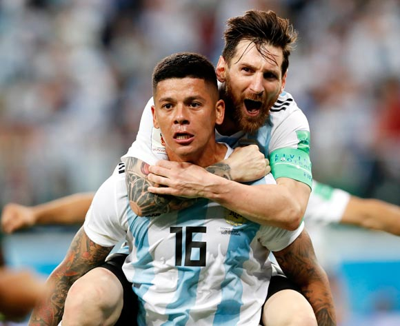 epa06842837 Marcos Rojo of Argentina celebrates with teammate Lionel Messi (top) after scoring the 2-1 during the FIFA World Cup 2018 group D preliminary round soccer match between Nigeria and Argentina in St.Petersburg, Russia, 26 June 2018.