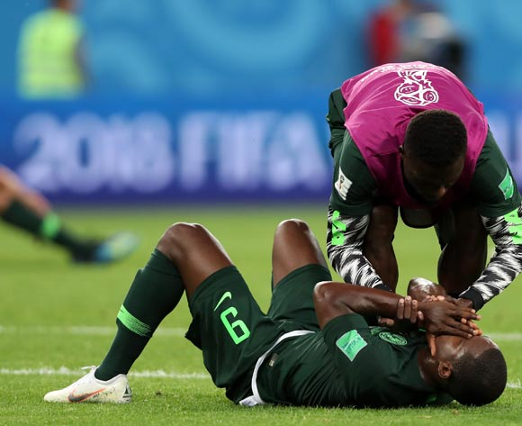 epa06842860 Odion Ighalo (down) of Nigeria reacts after the FIFA World Cup 2018 group D preliminary round soccer match between Nigeria and Argentina in St.Petersburg, Russia, 26 June 2018.