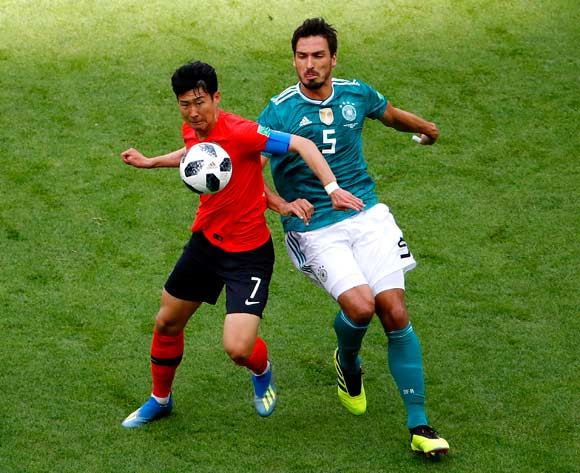 epa06844183 Son Heung-min of South Korea (L) and Mats Hummels of Germany in action during the FIFA World Cup 2018 group F preliminary round soccer match between South Korea and Germany in Kazan, Russia, 27 June 2018.