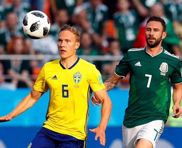 epa06844205 Ludwig Augustinsson (L) of Sweden in action against Miguel Layun (R) of Mexico during the FIFA World Cup 2018 group F preliminary round soccer match between Mexico and Sweden in Ekaterinburg, Russia, 27 June 2018.