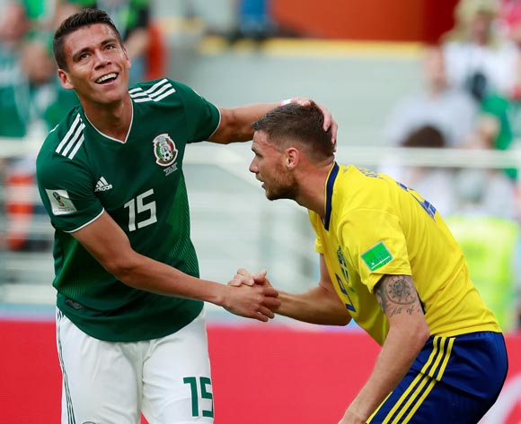 epa06844211 Mexican defender Hector Moreno (L) and Swedish forward Marcus Berg shake hands  during the FIFA World Cup 2018 Group F soccer match between Mexico and Sweden, in Ekaterinburg, Russia, 27 June 2018.