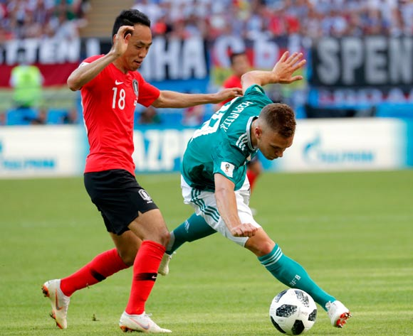 epa06844265 Moon Seon-min (L) of South Korea and Joshua Kimmich of Germany in action during the FIFA World Cup 2018 group F preliminary round soccer match between South Korea and Germany in Kazan, Russia, 27 June 2018.