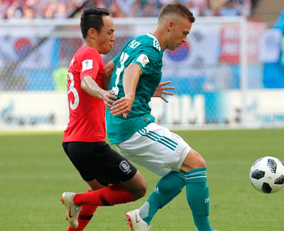 epa06844300 Moon Seon-min (L) of South Korea and Joshua Kimmich of Germany in action during the FIFA World Cup 2018 group F preliminary round soccer match between South Korea and Germany in Kazan, Russia, 27 June 2018.