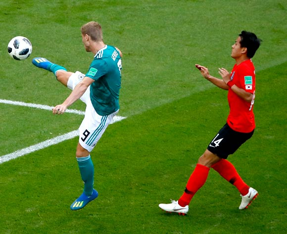 epa06844328 Hong Chul of South Korea (R) and Timo Werner of Germany in action during the FIFA World Cup 2018 group F preliminary round soccer match between South Korea and Germany in Kazan, Russia, 27 June 2018.