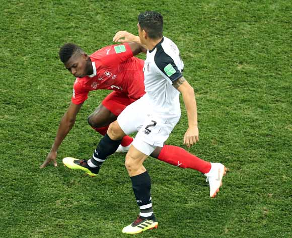 epa06845278 Johnny Acosta of Costa Rica (R) and Breel Embolo of Switzerland in action the FIFA World Cup 2018 group E preliminary round soccer match between Switzerland and Costa Rica in Nizhny Novgorod, Russia, 27 June 2018.