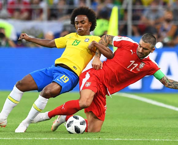 epa06845383 Willian (L) of Brazil in action against Aleksandar Kolarov (R) of Serbia during the FIFA World Cup 2018 group E preliminary round soccer match between Serbia and Brazil in Moscow, Russia, 27 June 2018.