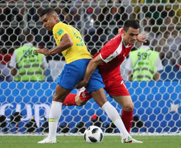epa06845768 Casemiro (L) of Brazil and Filip Kostic of Serbia in action during the FIFA World Cup 2018 group E preliminary round soccer match between Serbia and Brazil in Moscow, Russia, 27 June 2018.