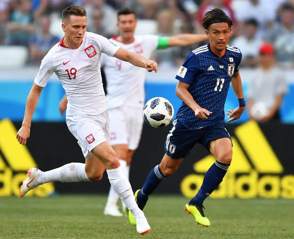 epa06847464 Poland's Piotr Zielinski (L) in action against Japan's Takashi Usami (R) during the FIFA World Cup 2018 group H preliminary round soccer match between Japan and Poland in Volgograd, Russia, 28 June 2018.