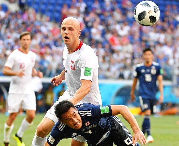 epa06847608 Poland's Rafal Kurzawa (L) in action against Japan's Shinji Okazaki (R)  during the FIFA World Cup 2018 group H preliminary round soccer match between Japan and Poland in Volgograd, Russia, 28 June 2018.