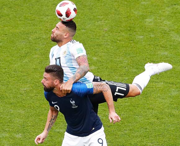 epa06852041 Nicolas Otamendi (back) of Argentina in action against Olivier Giroud (front) of France during the FIFA World Cup 2018 round of 16 soccer match between France and Argentina in Kazan, Russia, 30 June 2018.