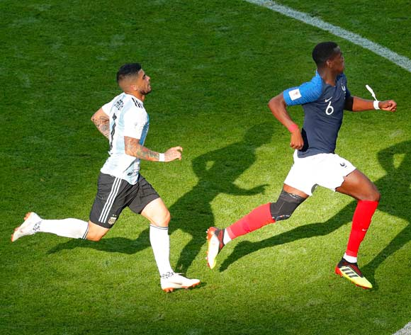 epa06852045 Ever Banega (L) of Argentina in action against Paul Pogba (R) of France during the FIFA World Cup 2018 round of 16 soccer match between France and Argentina in Kazan, Russia, 30 June 2018.