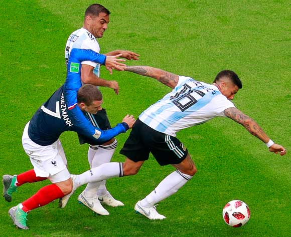 epa06852073 Antoine Griezmann (L) of France in action against Argentinian players Gabriel Mercado (C) and Marcos Rojo (R) during the FIFA World Cup 2018 round of 16 soccer match between France and Argentina in Kazan, Russia, 30 June 2018.