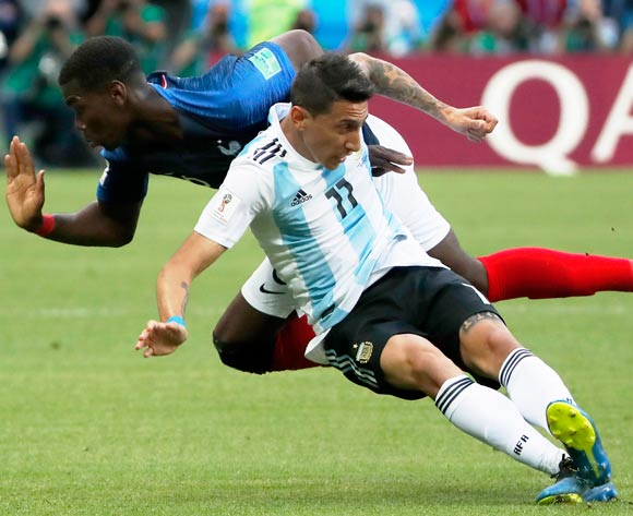 epa06852078 Angel Di Maria (R) of Argentina and Paul Pogba of France in action during the FIFA World Cup 2018 round of 16 soccer match between France and Argentina in Kazan, Russia, 30 June 2018.